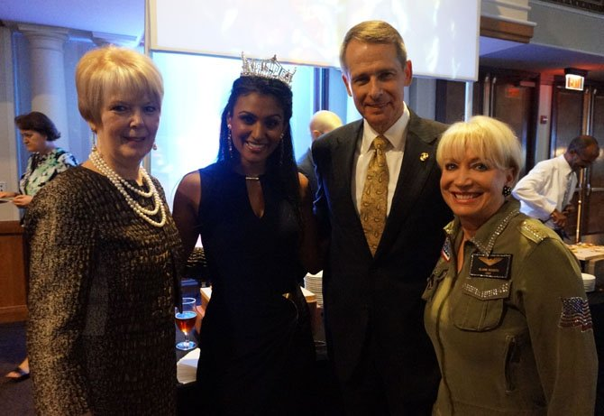 Former Chairman of the Joint Chiefs of Staff Gen. Peter Pace (ret., second from right) is joined by his wife Lynne Pace, left, Miss America Nina Davuluri, and USO-Metro president and CEO Elaine Rogers at the USO Stars and Stripes Night gala Oct. 4 at the Sheraton National Hotel in Arlington.