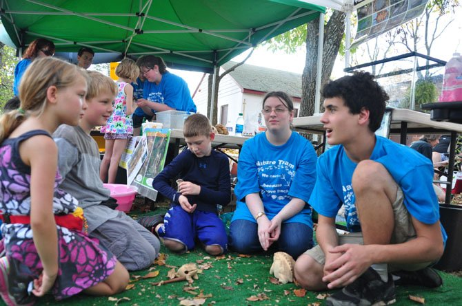 Volunteers from Nature's Web, LLC explain the nature of toads to guests at the annual Runnymede Park NatureFest Sunday, Oct. 6.