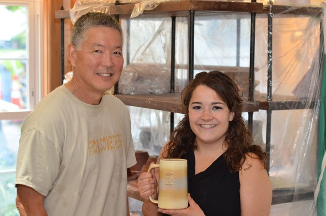 Steven Shiraishi and Olivia DiBenigno inside the Potter's Fire studio.