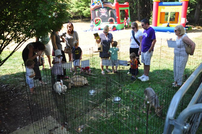 Guests at the St. Francis Country Fair explore the petting zoo Saturday, Oct. 5.