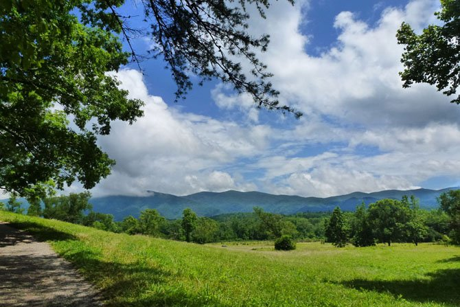 """Sunny Day in Cades Cove"" captures the intense blues and greens of this place in Great Smoky Mountain National Park."