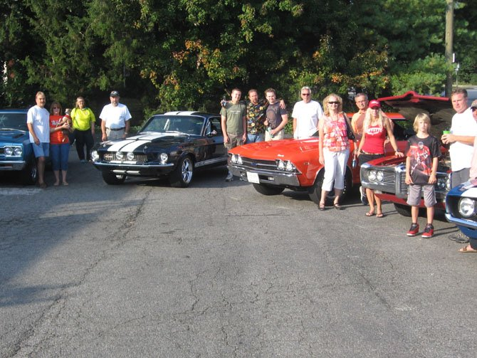 Local classic car owners meet at the Hollin Hall Shopping Center.