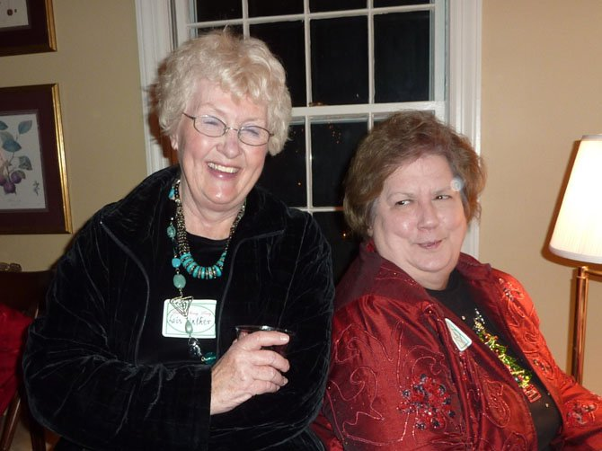 Lois Walker, left, was an organizer of the popular women's Sherry Party. She is shown at a previous party with Sherry Brown.