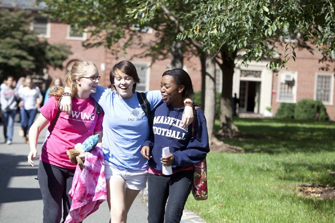 These students at The Madeira School in McLean, enjoy each other's company on campus. School visits offer prospective families an opportunity to learn about student life.