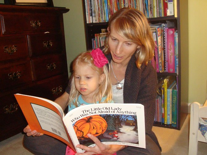 "Holly Karapetkova reads the Halloween book ""The Little Old Woman Who Was Not Afraid of Anything"" with her daughter. ""The main thing about reading with your child is giving your child your attention and having quality fun time together,"" she said."
