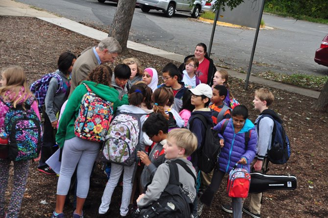Supervisor John Foust (D-Dranesville) greets Spring Hill Elementary School students who biked or walked to school Wednesday, Oct. 9.