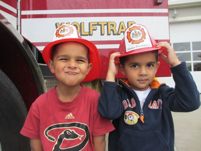 Thomas Shanmugam, 5, and his brother William, 4, of Great Falls, visited the newly-opened Wolftrap fire station at the intersection of Rt. 7 and Beulah Road in Vienna.