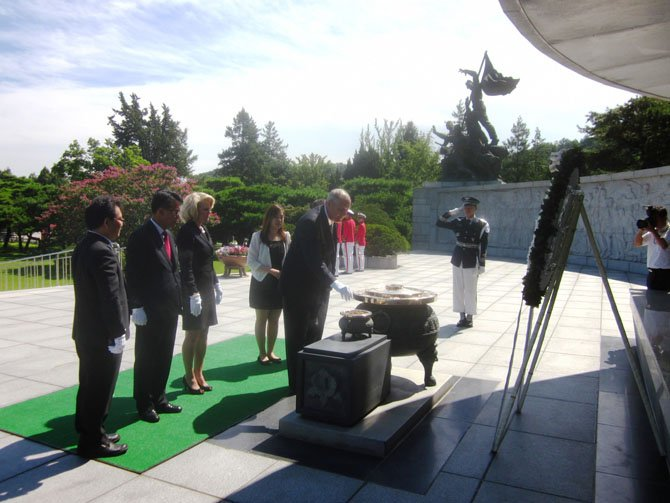"State Sen. Dave Marsden (D-37) participates in a wreath-laying ceremony at the Korean National Ceremony where the Korean War dead are buried. In August, Marsden and his wife, Julia, spent a week in South Korea as guests of the Government of the Republic of Korea. He was invited to discuss his sponsorship of the ""East Sea"" bill, and also to present a resolution from the Southern Legislative Conference encouraging trade development between the United States and Korea."