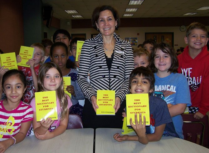 Sonia Castillo-Smith from the Rotary Club of Reston visits Aldrin Elementary. She presented dictionaries to all Aldrin third grade students on behalf of Rotary.