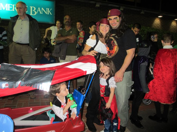 A pirate family views the Vienna Halloween Parade in 2012.