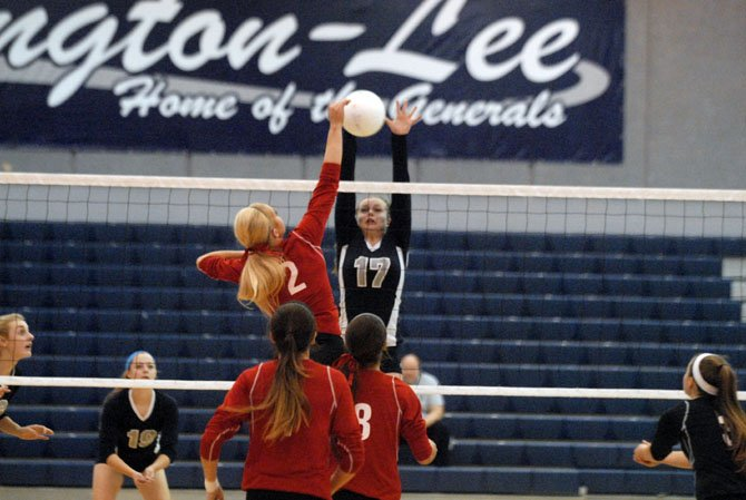Washington-Lee senior Audrey Batcheller goes up for a block during Monday's match against Madison.