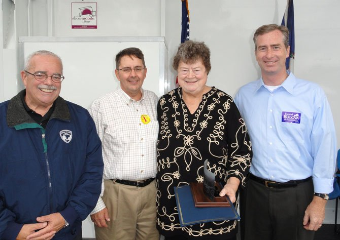 From left are U.S. Rep. Gerry Connolly (D-11) Supervisor Michael R. Frey (R-Sully), Trudy Harsh and Del. David Bulova (D-37) at the awards ceremony.