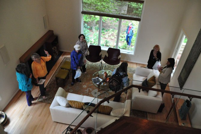 Reston Home Tour visitors explore the living room of Peter and Nedra Agnew Saturday, Oct. 19, one of the stops on the annual Reston Home Tour.