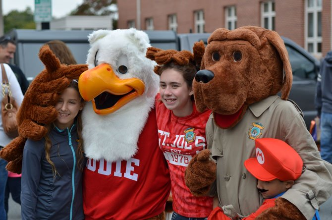 Eddie the Eagle and McGruff the Crime Dog pose for a picture. Students from St. Joseph's school in Herndon helped the costumed mascots.