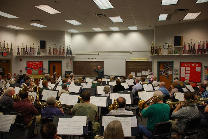 Robert Pouliot directs the City of Fairfax Band in a rehearsal at Washington Irving Middle School in Springfield.