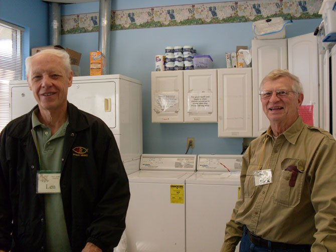 Volunteers Len Pomeroy and Dick Neff staffing the laundry.
