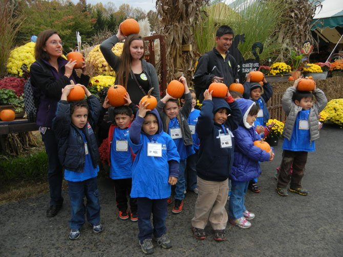Students and teachers from Newington Forest Head Start in Springfield show off their pumpkins.