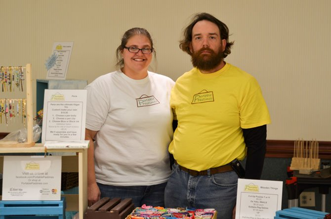 Chris and Therese Liebermann by their stand at the St. Joseph's Parish Craft Fair.