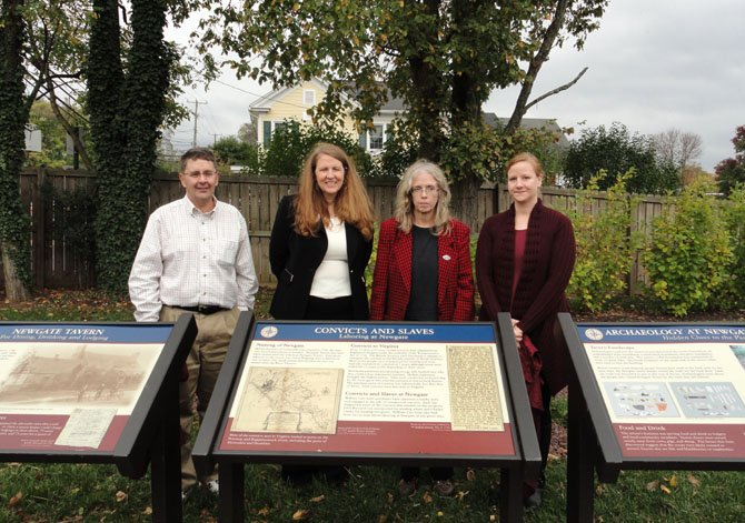 Together after the signs' unveiling are (from left) District Supervisor Michael Frey, Deborah Robison, Elizabeth Crowell and Kerri Holland, an archaeologist who participated in the Newgate excavation.