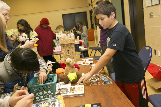 Young sellers offer bargains and learn the ins and outs of retail at the McLean Community Center's Children's Flea Market.