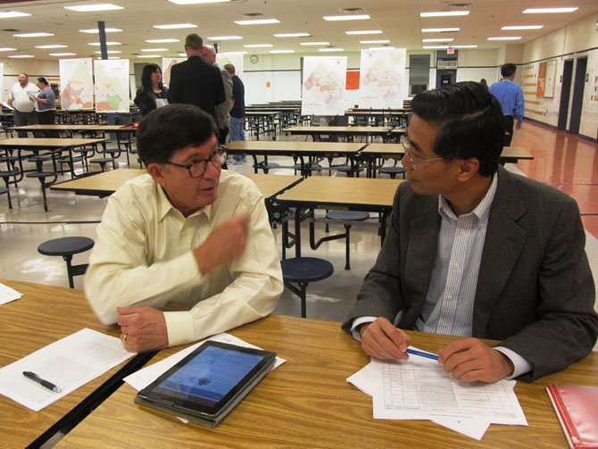"Alan Young of Burke, a member of FABB (Fairfax Advocates for Better Bicycling), talked with Jason Wu of Great Falls about the importance of bike and pedestrian-friendly transportation projects to ease congestion and make Fairfax County more ""livable"" at Hayfield High School Wednesday, Oct. 30."