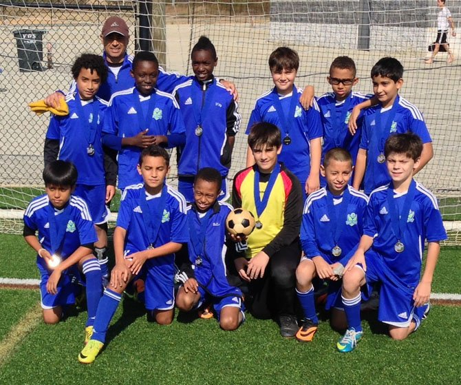 Reston United Blue (u12) team players are Lucas Banerji, William Burnett, Jackson Cooley, Bryan DeLaine, Amadou Diagne, Yaseen Elagazy, Xavier Kresslein, Jorge Manzano Garcia, Steven Otwell, Ulices Sanche, Sandro Welt and Topher Whomsley. The team is pictured with coach Kamal Ismail.