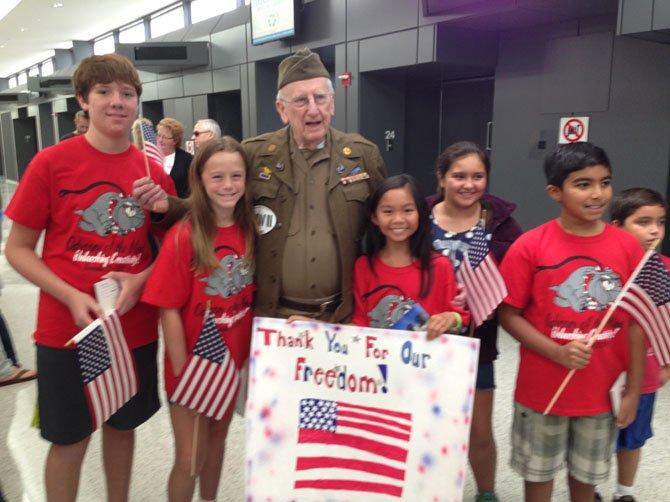 From left, Timothy Hutchinson, Caroline Keys, WWII Veteran Dick Graff, Sydney Pham, Angelina Rossi, Adit Khera.