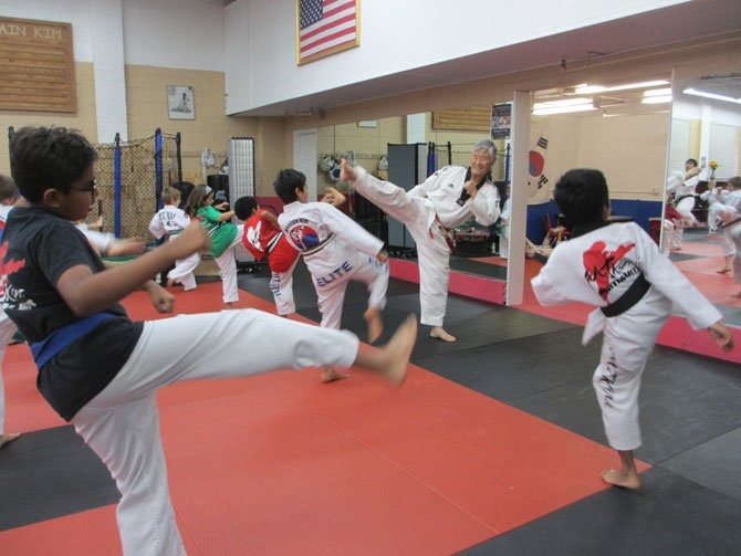 At 67 years old, Grand Master Mountain Kim can still do a high-kick. He began his own tae kwon do training 60 years ago.