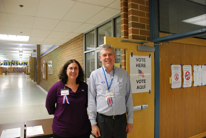 From left Robinson Secondary School Assistant Chief Election Officer Teri Ayers and Chief Election Officer James Emery Jr. welcome voters.