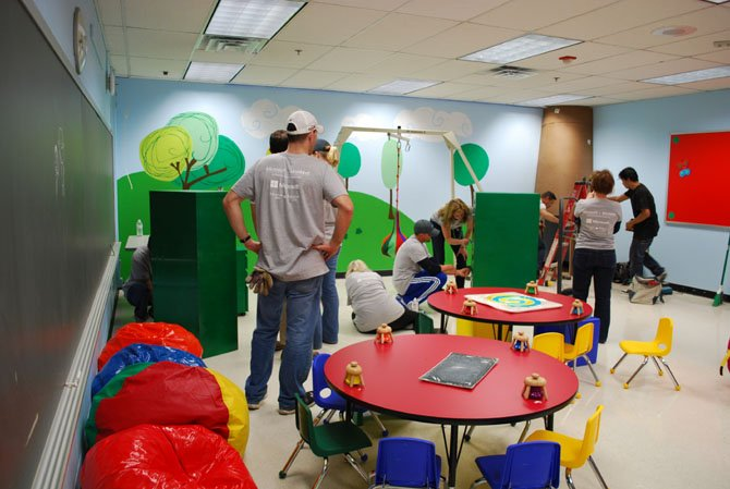 At Lynbrook Elementary School, the Sensory Room gets a makeover from Microsoft and MonkeeSee-MonkeeDo volunteers who painted wall, designed murals, and outfitted the room with new furniture and special technology during Saturday's makeover at Lynbrook.