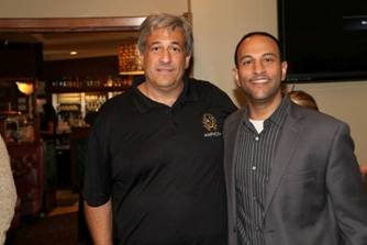 Amphora Owner George Cholakis stands with Eddie Fam, founder of the Meant 2 Live Foundation.