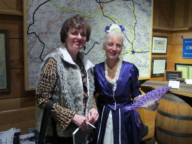 Garvey-Hodge poses with Kristi Roberts of Centreville, who spent 15 hours making the dress for the re-enactment.