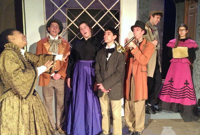 From left: Magali Palmer-Young directs carolers Bobby Kelleher, Sarah Giuseppe and Joey Arzeno, while Tommy Kelleher plays trumpet and Max Snyder and Isabella Whitfield chat.