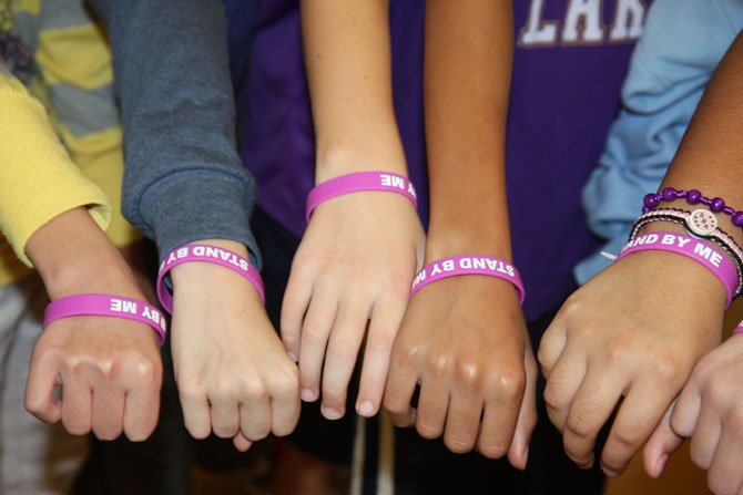 "Lees Corner Elementary students show their ""Stand by Me"" wristbands."