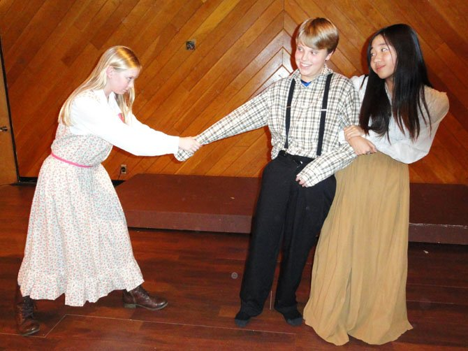 From left are Noelle Buice, Jack Wood and Jenny Lee, showing Amy Lawrence and Becky Thatcher fighting over Tom Sawyer.