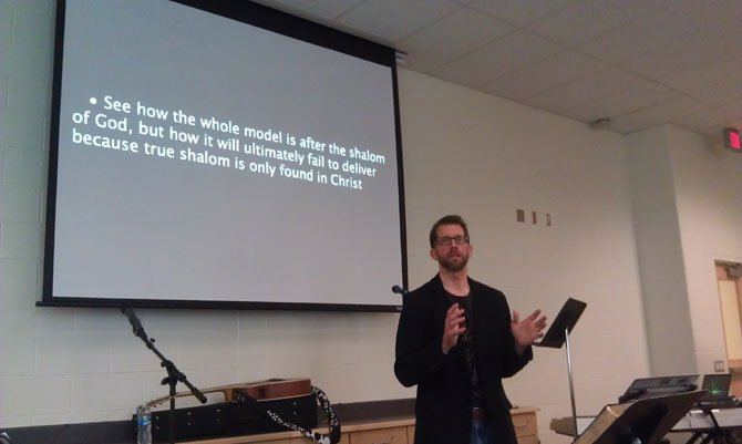Pastor Scott Maurer speaks during one of West City Fellowship's Sunday services.