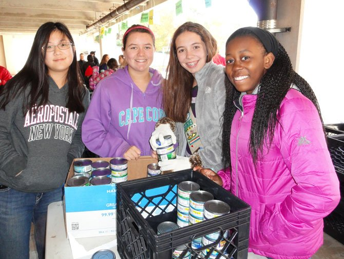 From left: Westfield High students Sarah Pak, Nicole Ruckert, Lauren Peters and Summar Morgan sort donated canned goods.