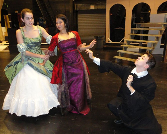 From left: Olivia Witt (as Maria) and Elizabeth Coo (as Olivia) are repulsed by the advances of Malvolio, played by Julian Sanchez.
