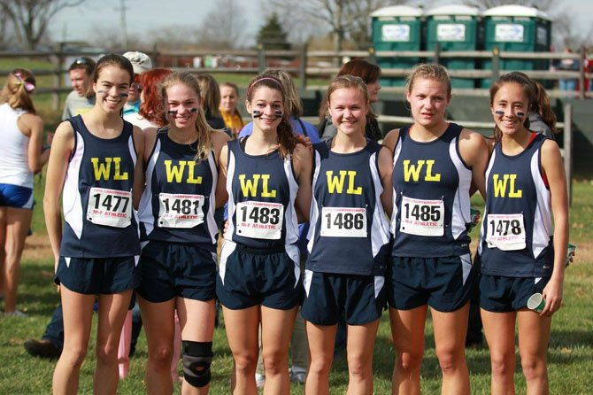 The Washington-Lee girls' cross country team placed second among 6A teams at the state meet on Nov. 15 at Great Meadow. From left are Sarah Angell, Annika Macewen, Donia Nichols and Jordan Selby, Sarah Sears and Kathryn Eng.