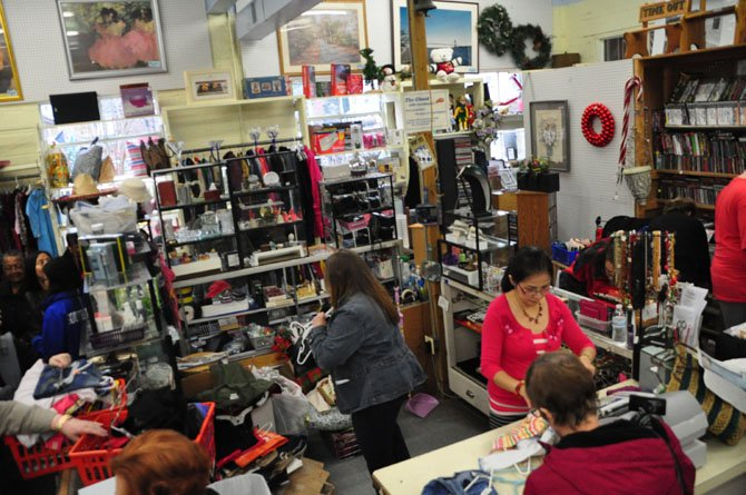 Shoppers browse The Closet in Herndon for gift ideas.