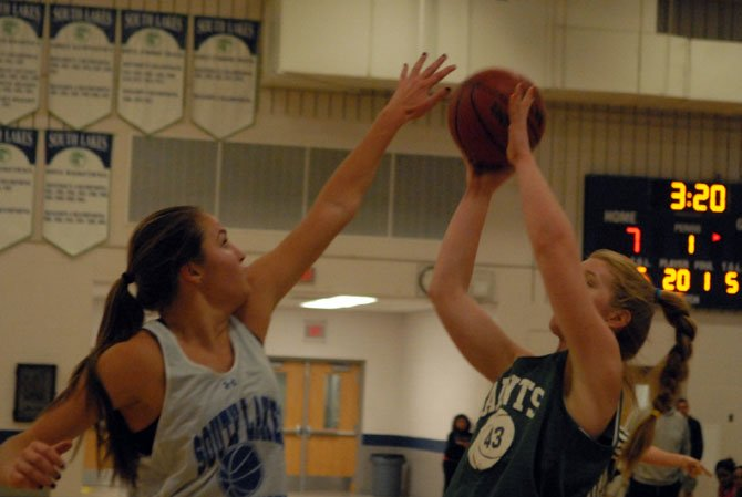 Six-foot-4 senior Abby Rendle, left, is one of nine returning athletes on the 2013-14 South Lakes girls' basketball team.
