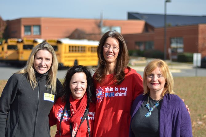 The 2012-13 Dranesville Elementary PTA Officers (from left) Christine Brinson, PTA Vice President, Kelly Smith, PTA Correspondence Secretary, Kim Baker Recording Secretary, and Rachel Gross, PTA President. In the background is Dranesville Elementary.