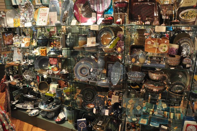 Shelves of handmade pottery and other items available at The Artisans in McLean.