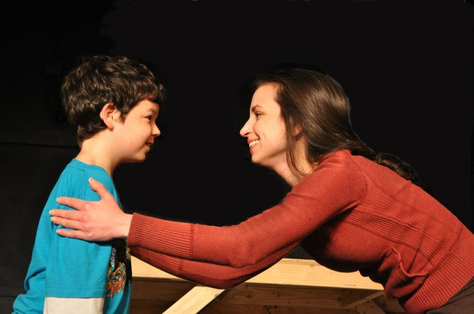 """Brendan Dure as Little Scrooge and Eryn Gleason as Fan in rehearsal for the Providence Players' production of the family holiday classic """"A Christmas Carol."""""""