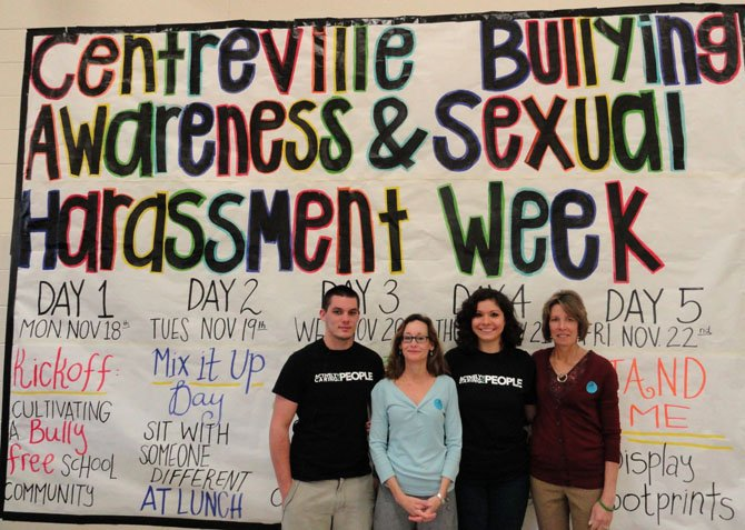 From left: Alex Jones, Lu Ann McNabb, Sophia Teie and Debbie Lawall in front of Centreville High's anti-bullying-week banner in the cafeteria.