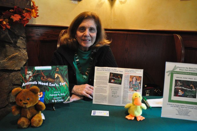 "Author Pat Britz signs copies of her book at Katie's Coffee Shop. The book, ""Animals Need Zzzs Too,"" addresses children's sleep habits."