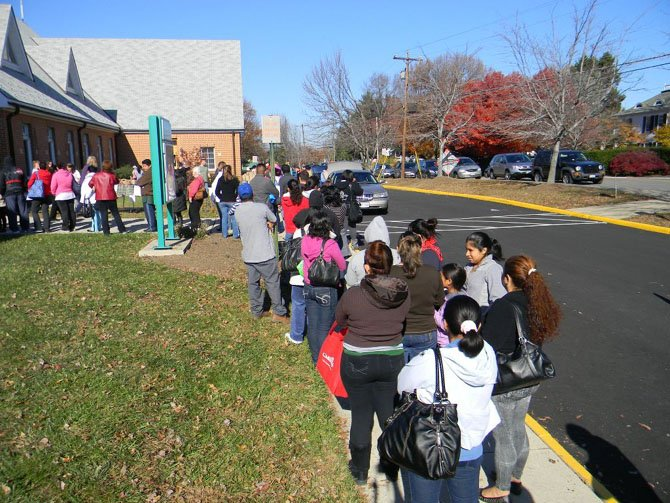 Needy families wait on line to receive groceries and gift certificates at Trinity Presbyterian Church in Herndon on Nov. 16. Sixty families an hour were escorted through the church supermarket during seven hour LINK event. www.linkagainsthunger.org 703-437-1776