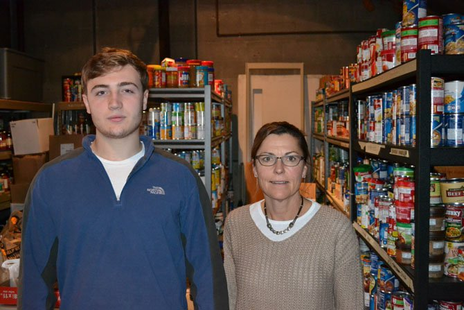 Forrest Crane, Senior at Potomac School, and Potomac School teacher Tracy Jaeger, helped Share prepare for Thanksgiving distribution day.