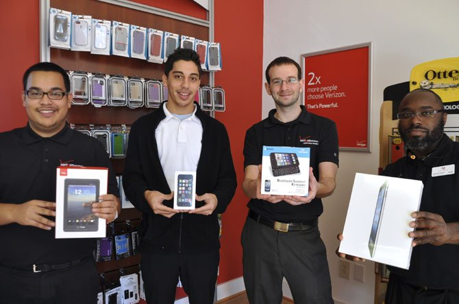 Verizon salesmen Luis Navarro, Luis Rivera, Manager Jason Vogel and Jermaine Boone are available to help select the perfect tech gift.