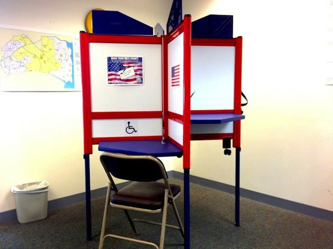 Paper ballots that were filled out in booths like these will have to be hand counted during the recount.